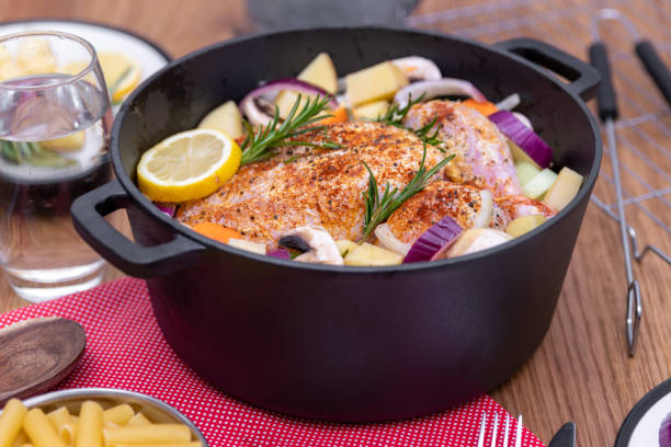 Preparing a whole chicken to cook in a Dutch Oven one pot stock photo
