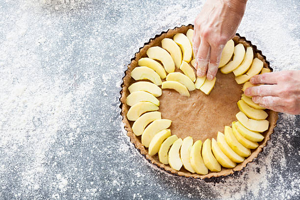 preparing an apple pie stock photo