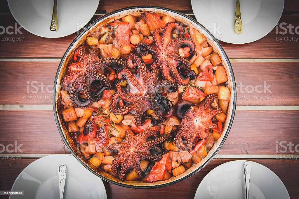 Preparing and Cooking of octopus in traditional Croatian peka Sa stock photo