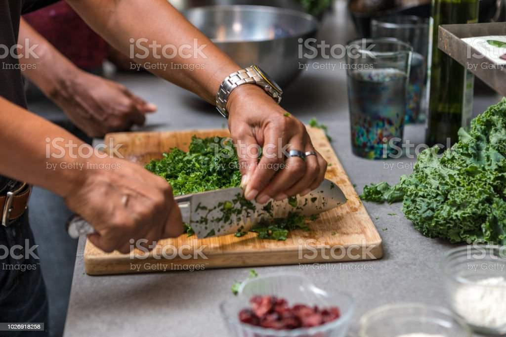 preparing and cutting kale to make a salad royalty-free stock photo