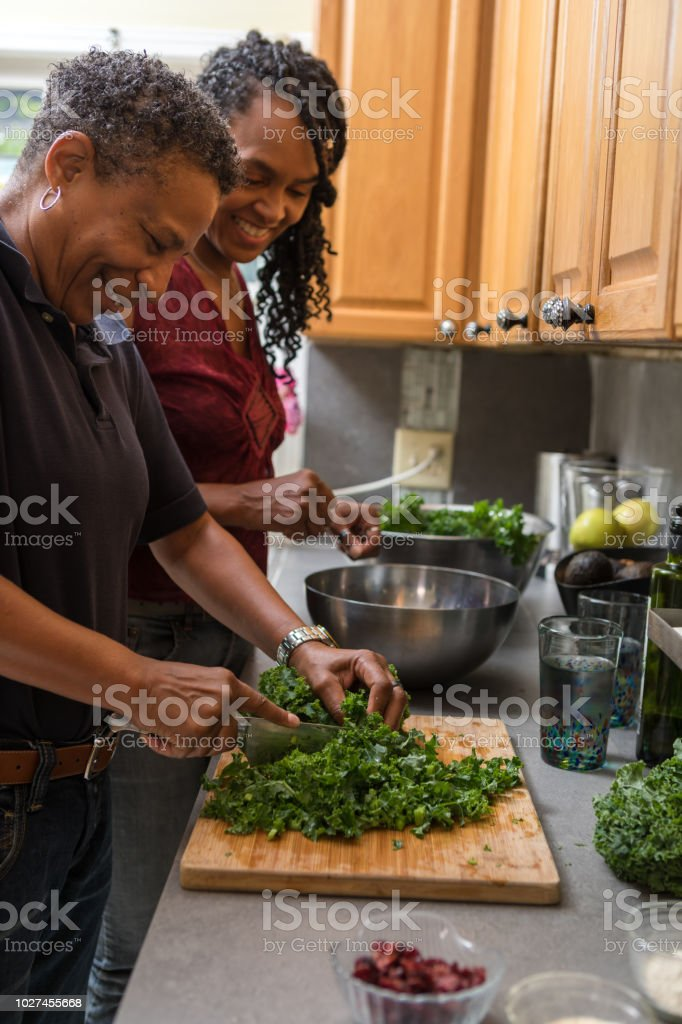 preparing and cutting kale to make a salad stock photo