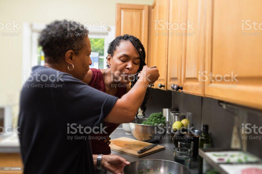 preparing and tasting food royalty-free stock photo