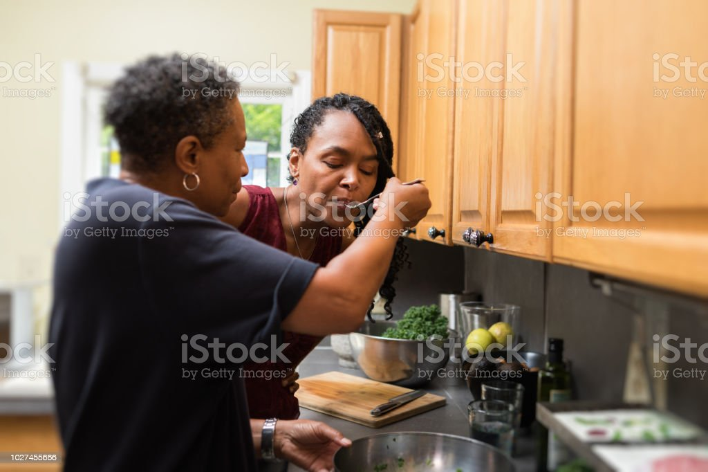 preparing and tasting food stock photo