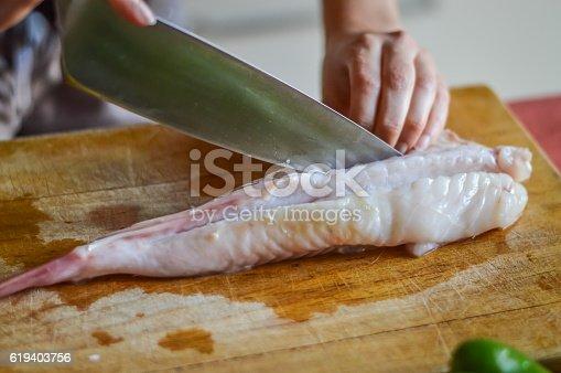 istock preparing anglerfish before cooking (Lophius piscatorius) 619403756