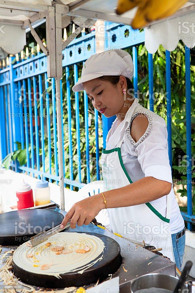 Preparing banana pancakes royalty-free stock photo