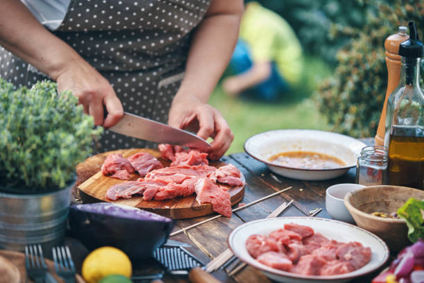 Preparing Beef Kebab with Vegetables Outside stock photo