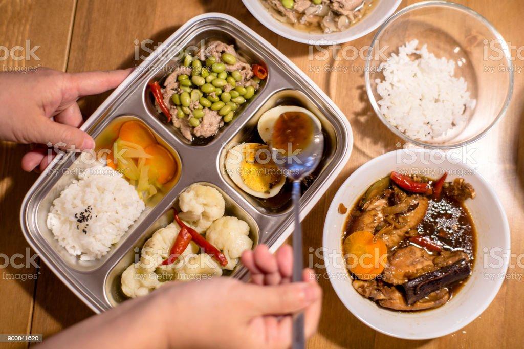 preparing bento lunch stock photo