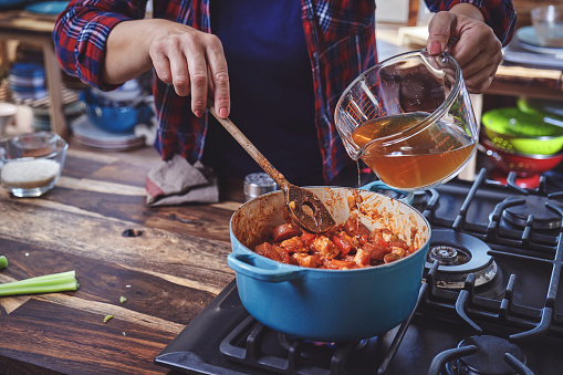 Preparing Cajun Style Chicken, Shrimp and Sausage Jambalaya in a Cast Iron Pot