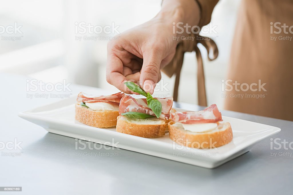 Preparing canapes stock photo