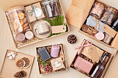 istock Preparing care package, seasonal gift box with coffee, cookies, candles, spices and cups 1281515407