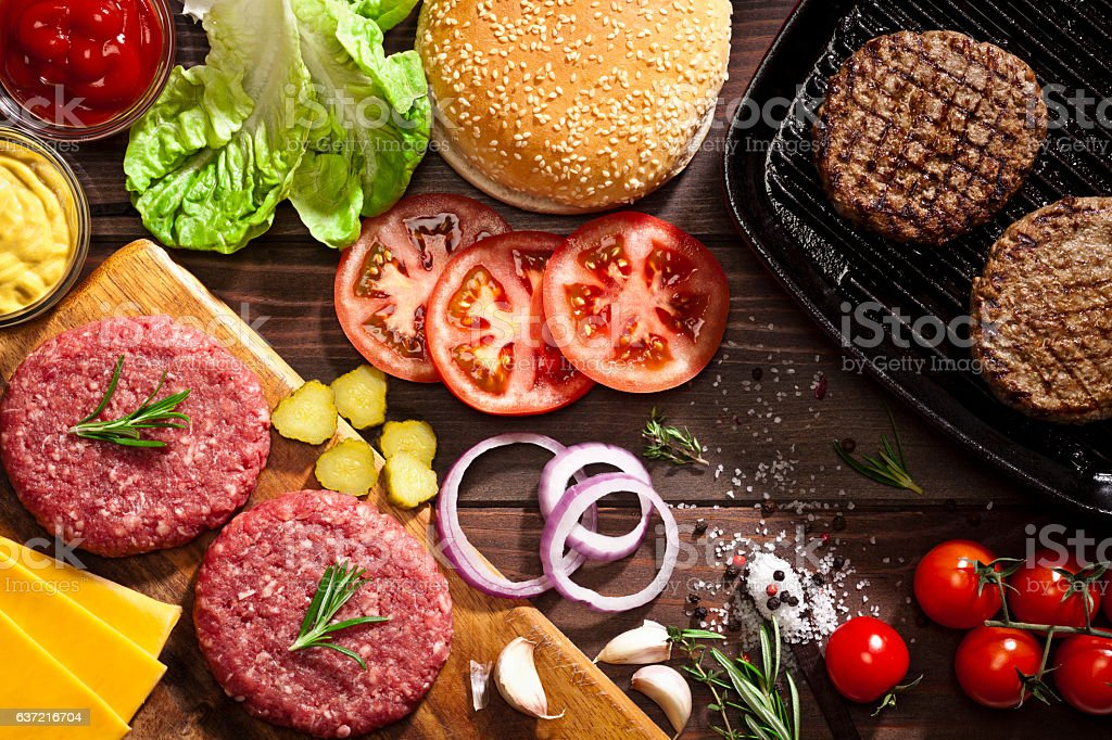 Preparing cheeseburger stock photo