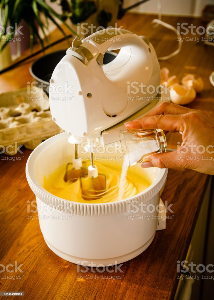Preparing cheesecake on table - Royalty-free Adult Stock Photo