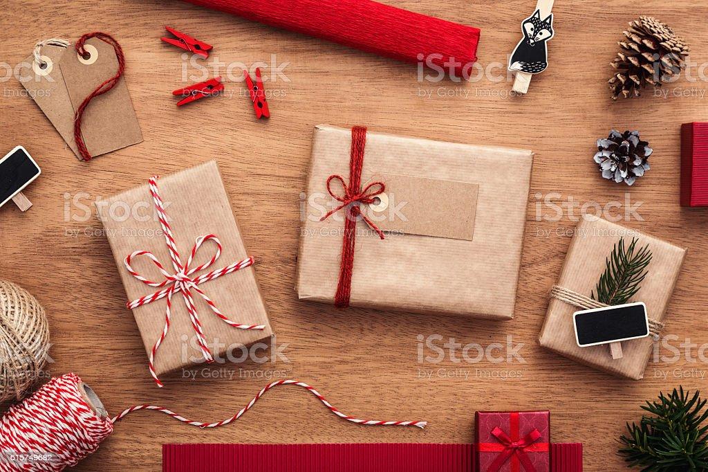 Preparing christmas gifts. Presents, cones, string, ribbon. stock photo