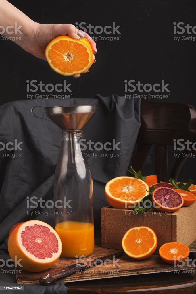 Preparing citrus fresh on black old chair royalty-free stock photo