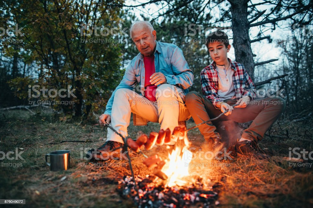 Preparing dinner in nature stock photo