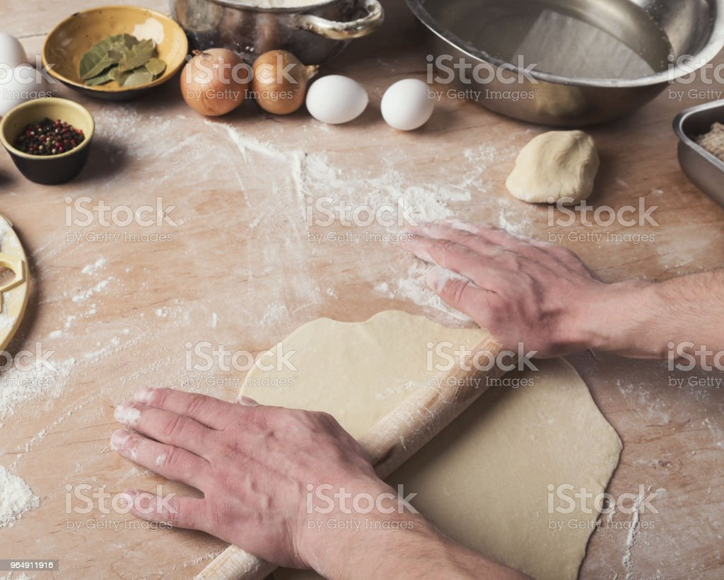 Preparing dumplings with meat, rolling out dough royalty-free stock photo