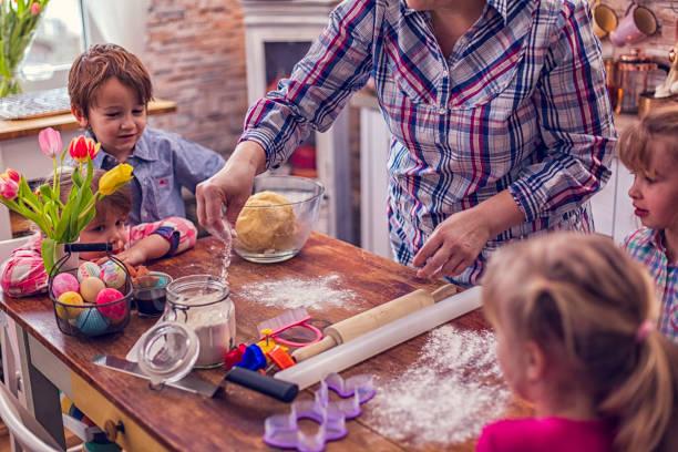 preparing easter cookies - buona pasqua in tedesco foto e immagini stock
