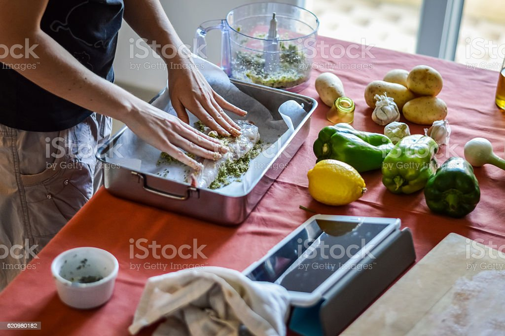 preparing fish - cooking with tablet foto royalty-free