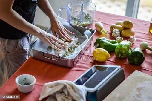 istock preparing fish - cooking with tablet 620980182