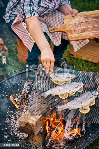 Preparing Fish for Cooking Over Open Campfire