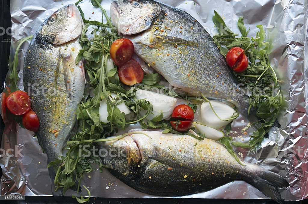 preparing fish for cooking royalty-free stock photo