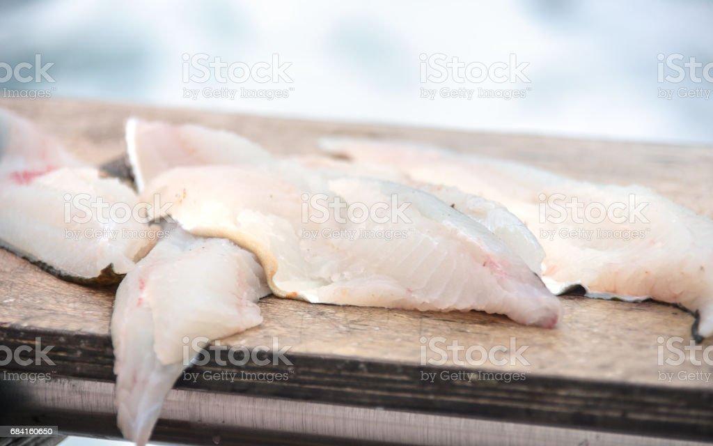 Preparing fish on boat royalty-free stock photo