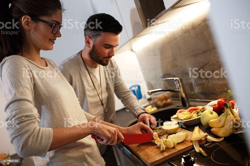 Preparing food at the kitchen stock photo