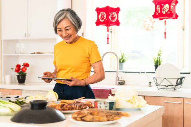 preparing food for chinese new year meal - chinese new year stock pictures, royalty-free photos & images
