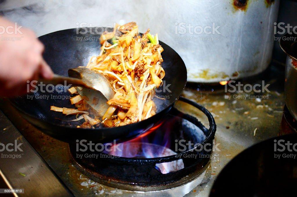 Preparing food in restaurant kitchen stock photo