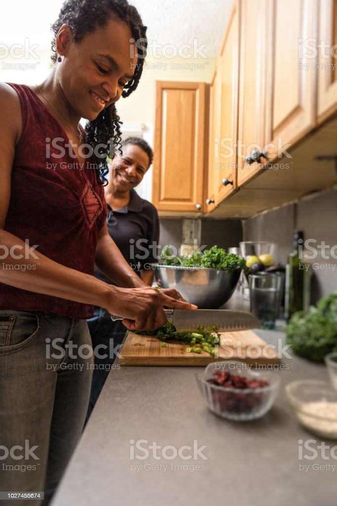 preparing food in the kitchen together royalty-free stock photo