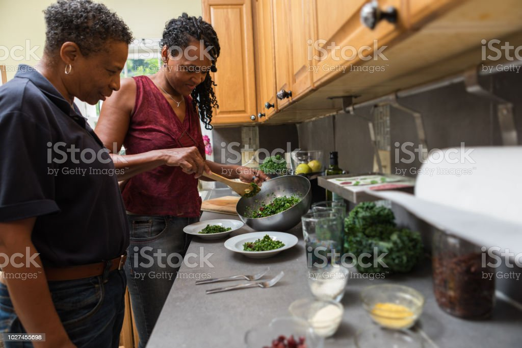 preparing food in the kitchen together stock photo
