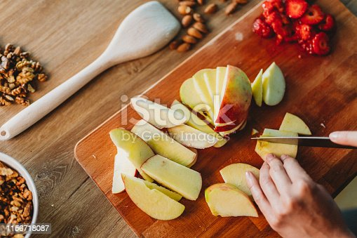 Woman cutting fruit in the kitchen