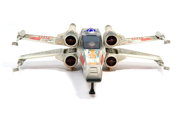 """Preparing for Attack """"Vancouver, Canada - March 18, 2012: A toy X-Wing fighter from the Star Wars film franchise, against a white background. The toy is made by Hasbro."""" flight suit stock pictures, royalty-free photos & images"""