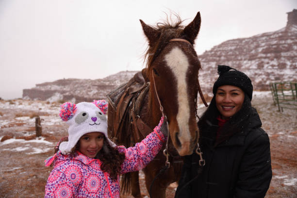 preparing for horse riding in utah - navajo culture stock photos and pictures