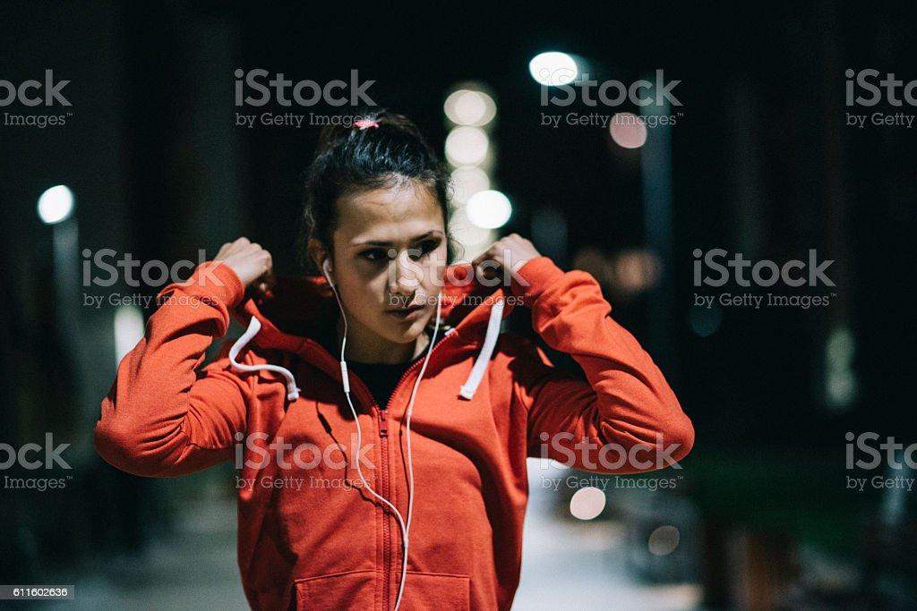Preparing for midnight workout in neighborhood stock photo