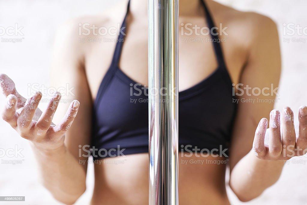 Preparing for pole dance stock photo