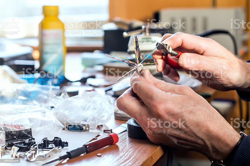 Preparing for soldering by stripping the wire stock photo