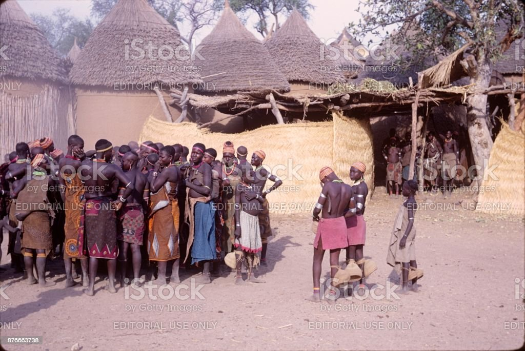 Preparing for the sickle dance ceremony in front of the king's huts stock photo