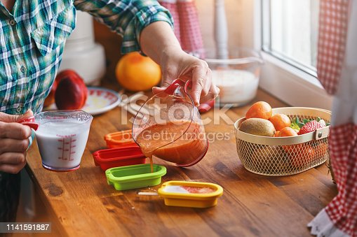 Preparing Fruit Ice Cream on Stick in Domestic Kitchen