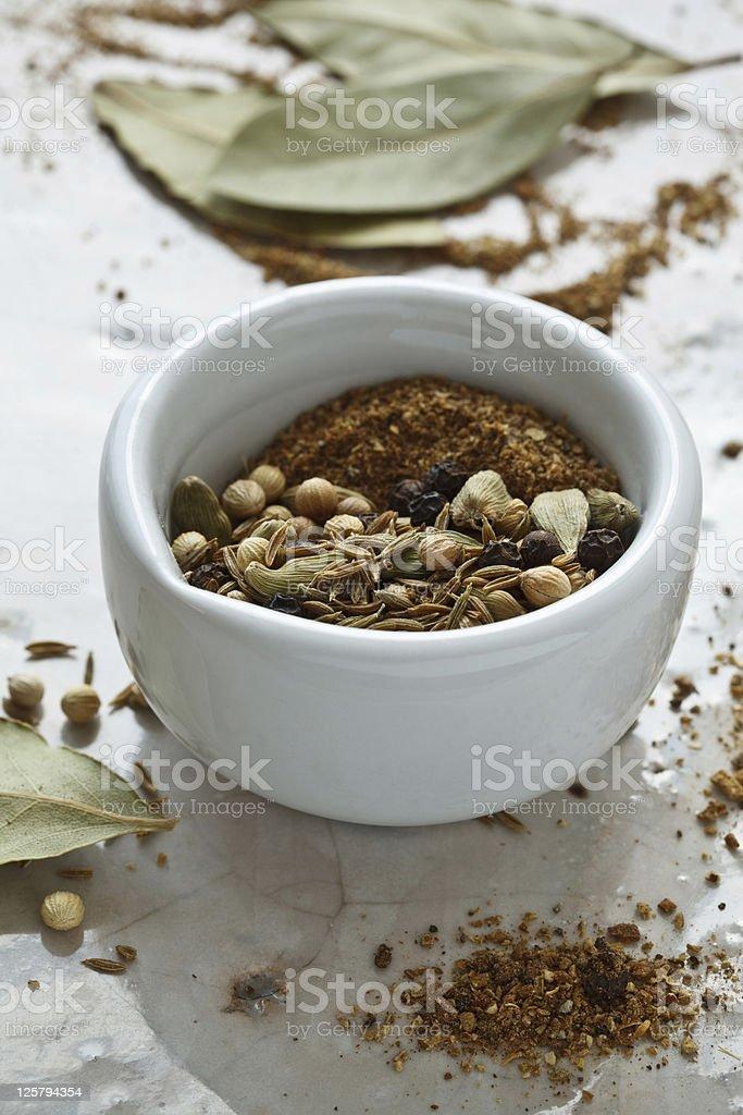 Preparing Garam Masala stock photo