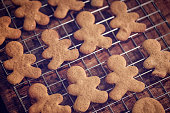 Preparing gingerbread man Christmas Cookies in domestic kitchen