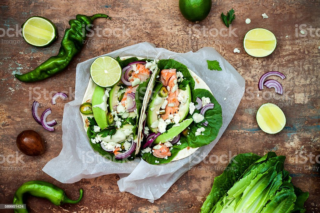 Preparing healthy lunch snacks. Fish tacos with grilled salmon stock photo