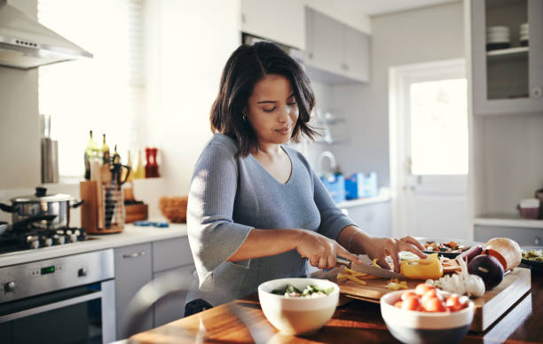 298,243 Woman Cooking Stock Photos, Pictures & Royalty-Free Images - iStock