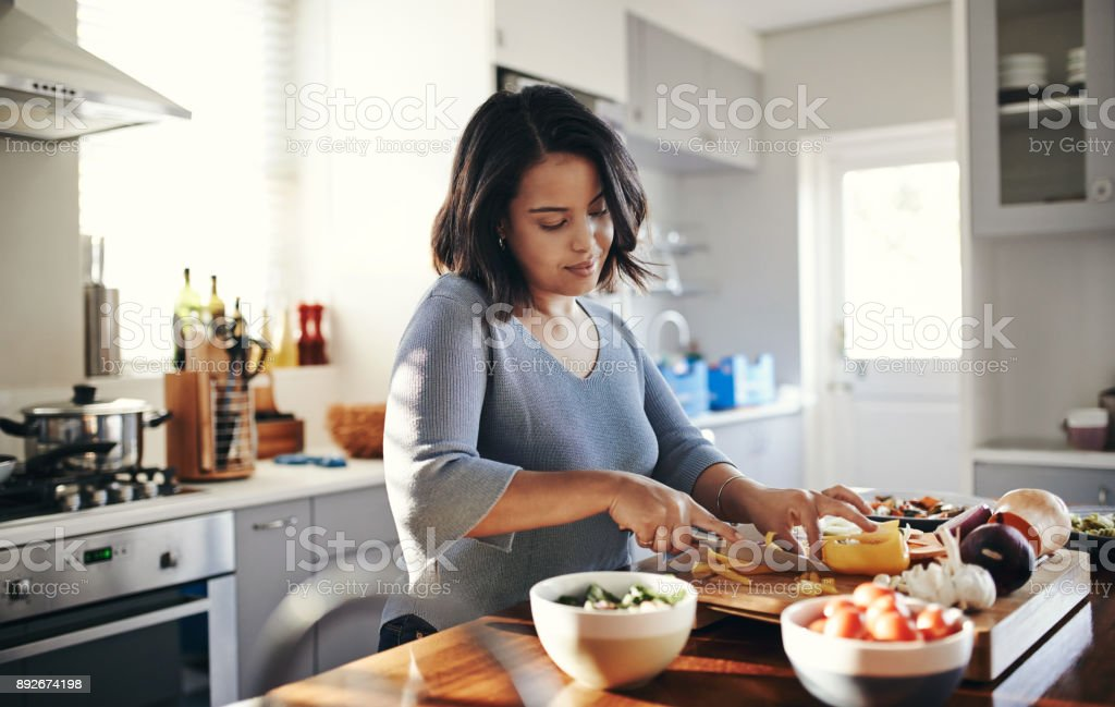 Preparing her favourite dish stock photo