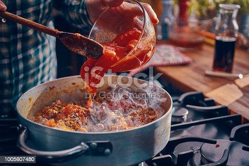 Preparing Homemade Spaghetti Bolognese in Domestic Kitchen