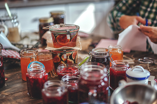 Preparing Homemade Strawberry, Blueberry and Raspberry Jam and Canning in Jars