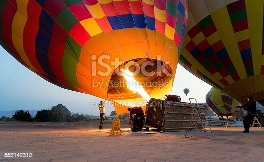 1035635902 istock photo Preparing Hot Air Balloons To Fly over Cappadocia 852142312