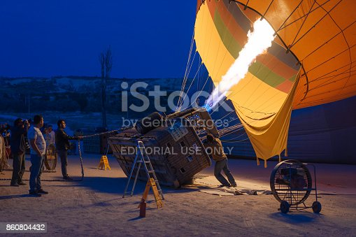 1035635902 istock photo Preparing Hot Air Balloons To Fly over Cappadocia 860804432