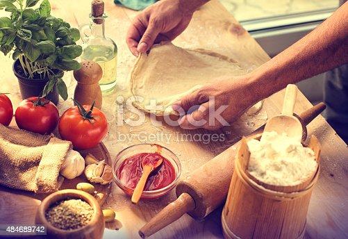 Preparing ingredients of homemade pizza