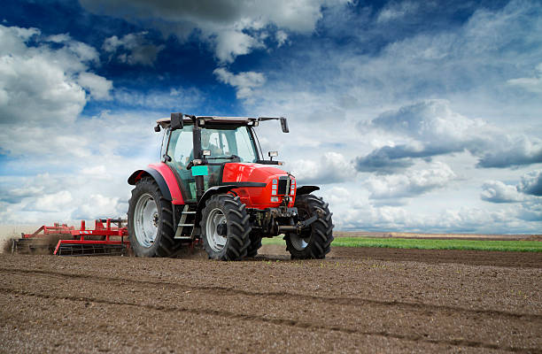 Preparing land for sowing at spring, farmer in tractor Preparing land for sowing at spring, farmer in tractor agricultural equipment stock pictures, royalty-free photos & images